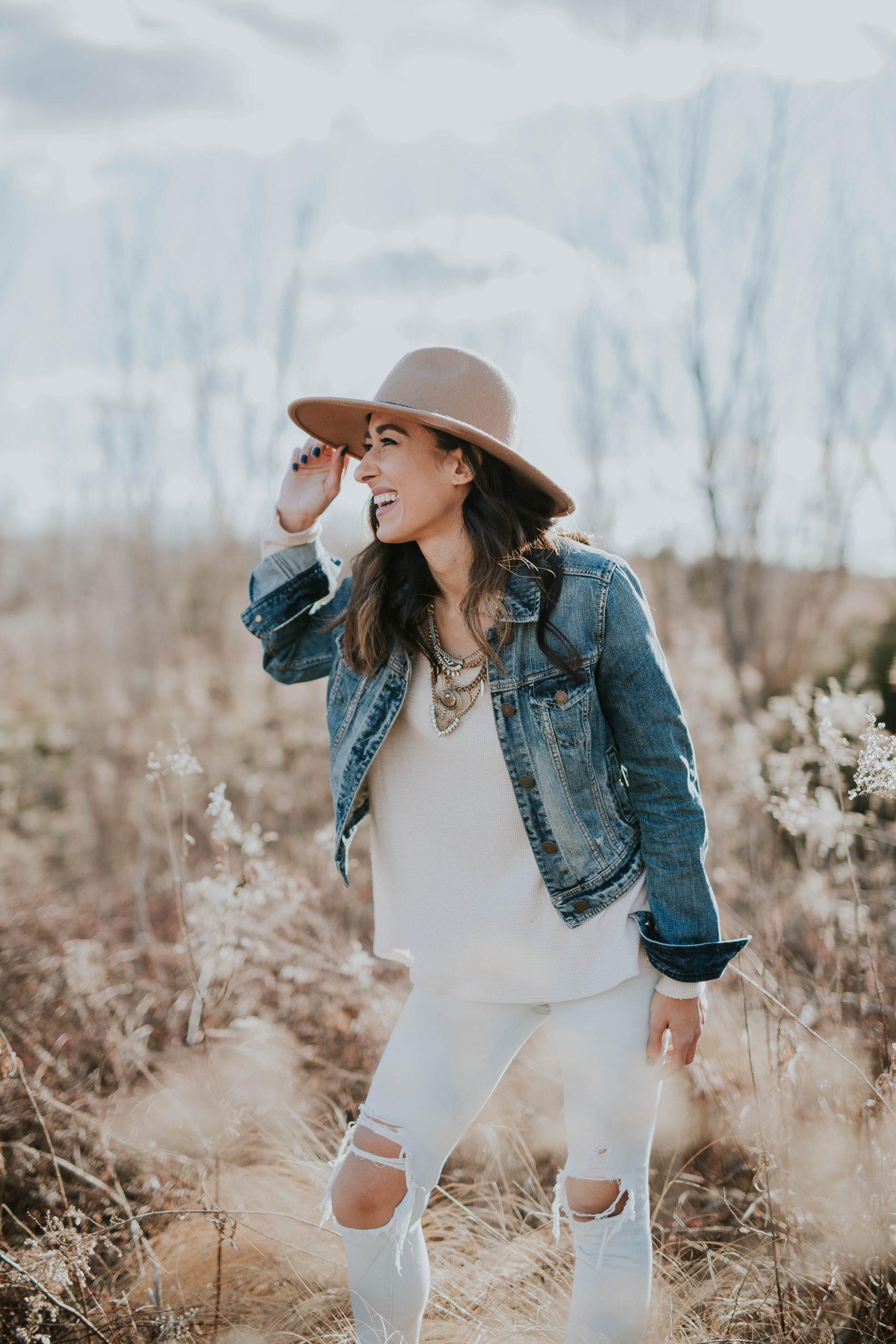girl in a hat in a field